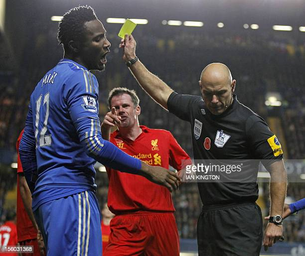 Chelsea's Nigerian midfielder John Mikel Obi reacts after referee Howard Webb shows Liverpool's Glen Johnson a yellow card during the English Premier...