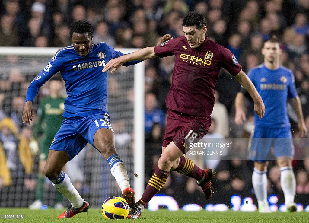 "Chelsea's Nigerian midfielder John Mikel Obi (L) vies for the ball against Manchester City's English midfielder Gareth Barry (C) during the English Premier League football match between Chelsea and Manchester City at Stamford Bridge stadium in London on November 25, 2012. USE. No use with unauthorized audio, video, data, fixture lists, club/league logos or ""live"" services. Online in-match use limited to 45 images, no video emulation. No use in betting, games or single club/league/player publications"