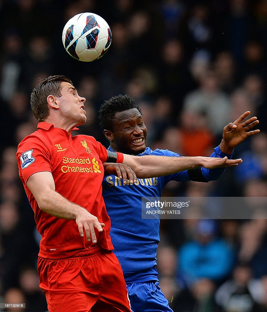 "Chelsea's Nigerian midfielder John Mikel Obi (R) vies with Liverpool's English midfielder Jordan Henderson (L) during the English Premier League football match between Liverpool and Chelsea at the Anfield stadium in Liverpool, northwest England, on April 21, 2013. USE. No use with unauthorized audio, video, data, fixture lists, club/league logos or ""live"" services. Online in-match use limited to 45 images, no video emulation. No use in betting, games or single club/league/player publications."
