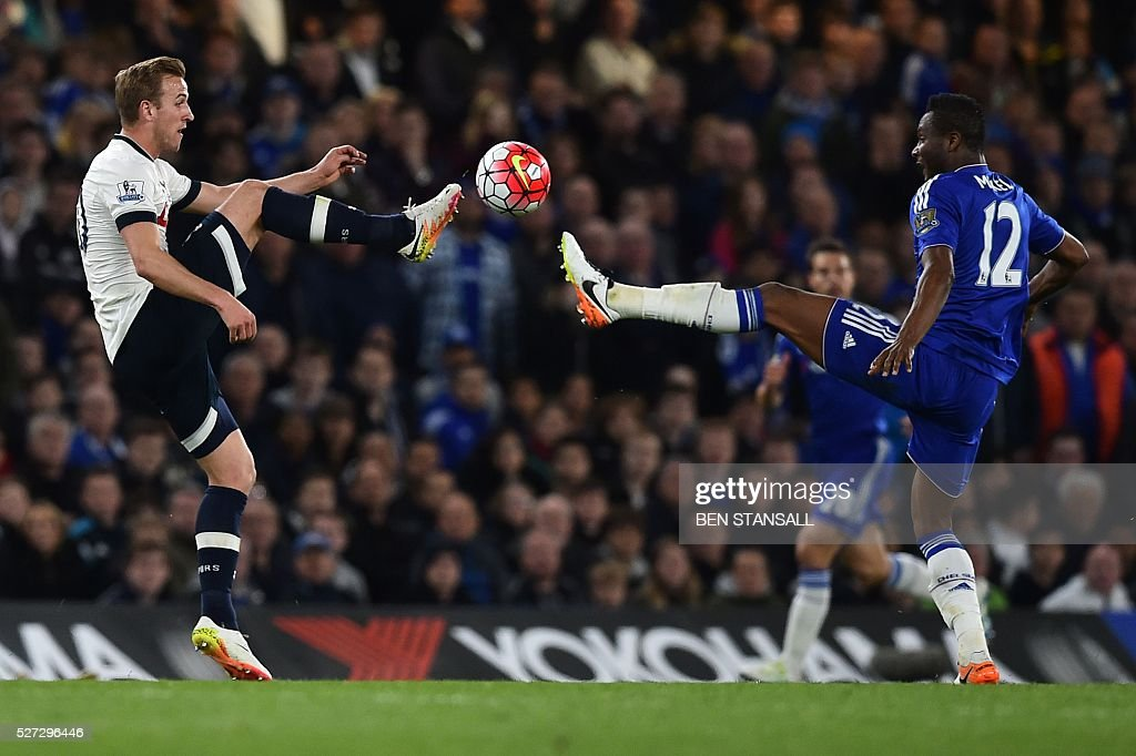 Chelsea's Nigerian midfielder John Obi Mikel (R) and Tottenham Hotspur's English striker Harry Kane (L) go for the ball during the English Premier League football match between Chelsea and Tottenham Hotspur at Stamford Bridge in London on May 2, 2016. / AFP / BEN STANSALL / RESTRICTED TO EDITORIAL USE. No use with unauthorized audio, video, data, fixture lists, club/league logos or 'live' services. Online in-match use limited to 75 images, no video emulation. No use in betting, games or single club/league/player publications. /