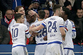 Chelsea's Nigerian midfielder John Obi Mikel celebrates with teammates after scoring a goal during the Champions League round of 16 first leg...