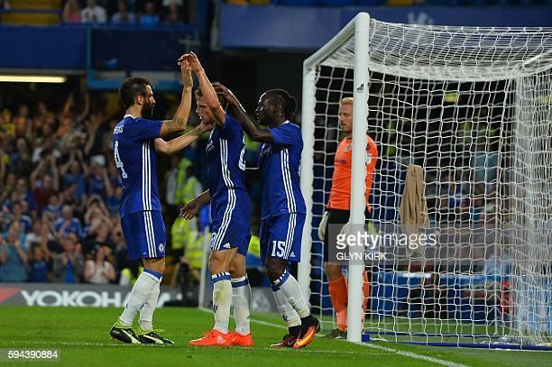 Chelsea's Nigerian midfielder Victor Moses celebrates with Chelsea's Spanish defender Cesar Azpilicueta and Chelsea's Spanish midfielder Cesc...