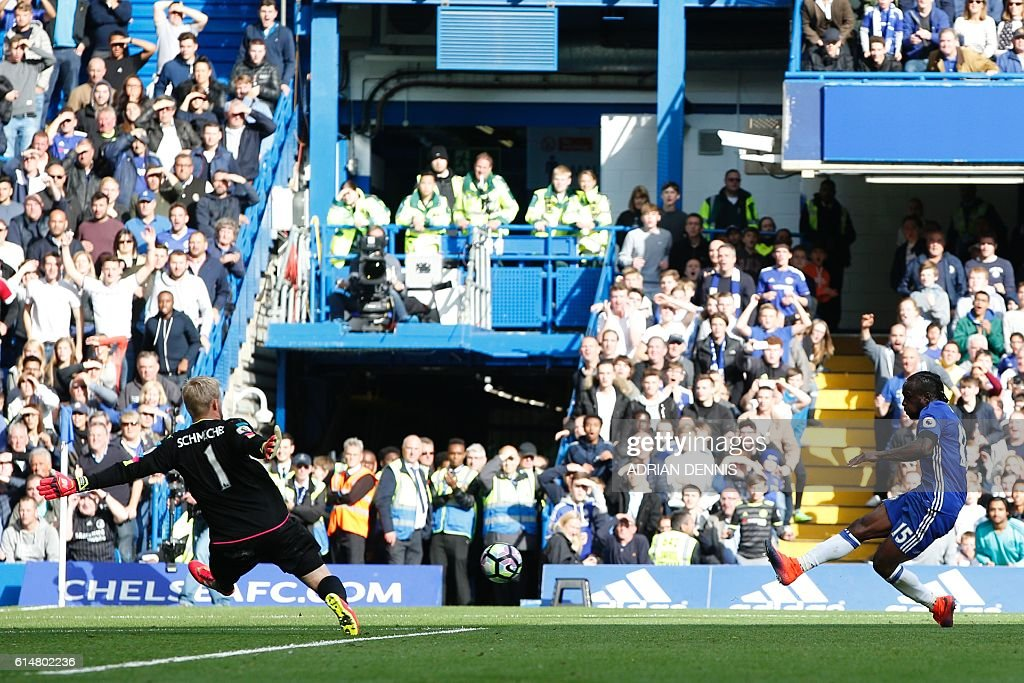 Chelsea's Nigerian midfielder Victor Moses (R) shoots to score their third goal past Leicester City's Danish goalkeeper Kasper Schmeichel (L) during the English Premier League football match between Chelsea and Leicester City at Stamford Bridge in London on October 15, 2016. / AFP / Adrian DENNIS / RESTRICTED TO EDITORIAL USE. No use with unauthorized audio, video, data, fixture lists, club/league logos or 'live' services. Online in-match use limited to 75 images, no video emulation. No use in betting, games or single club/league/player publications. /
