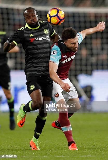 Chelsea's Nigerian midfielder Victor Moses vies with West Ham United's Scottish midfielder Robert Snodgrass during the English Premier League...