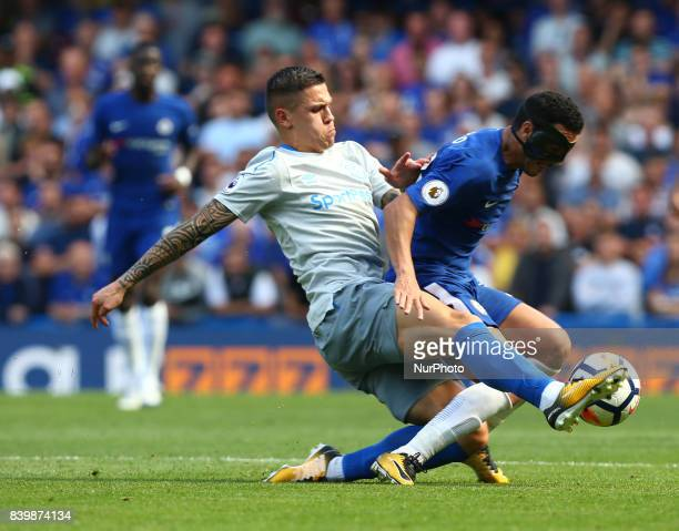 Chelsea's Pedro gets tackled by Everton's Muhamed Besic during the Premier League match between Chelsea and Everton at Stamford Bridge London England...