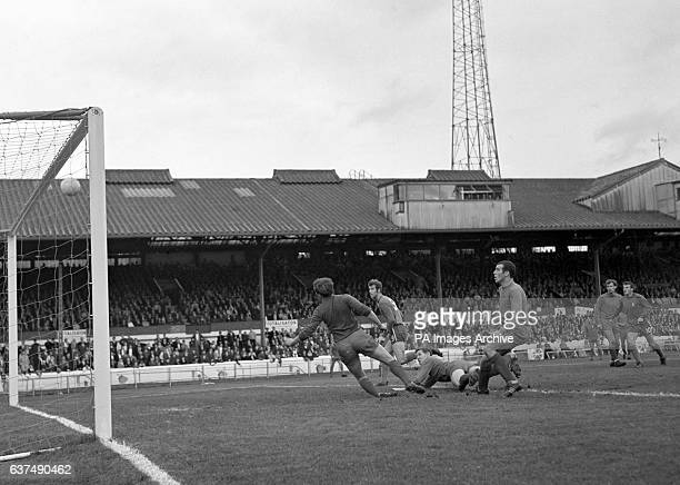 Chelsea's Peter Osgood beats Coventry City defender Tony Knapp and goalkeeper Bill Glazier to the ball only for his header to hit the cross bar
