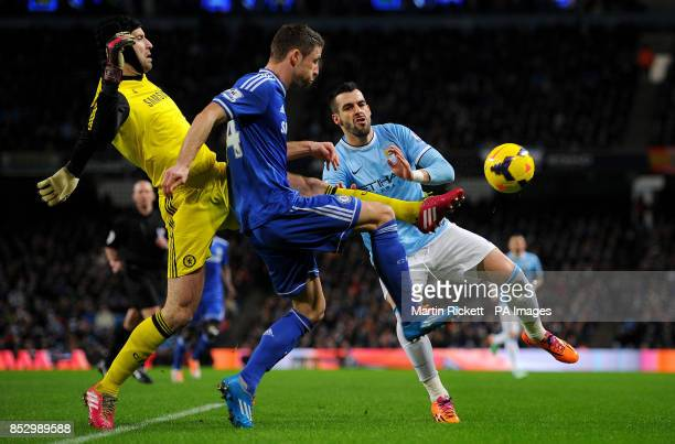 Chelsea's Petr Cech and Gary Cahill clear the ball from Manchester City's Alvaro Negredo during the Barclays Premier League match at The Etihad...