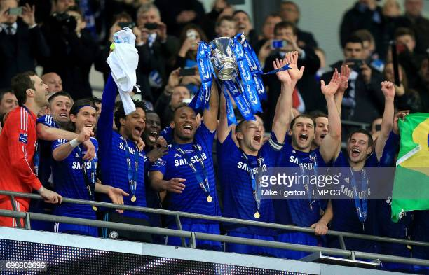 Chelsea's Petr Cech Gary Cahill Filipe Luis Loic Remy Didier Drogba John Terry Branislav Ivanovic and Cesar Azpilicueta celebrate with the Capital...