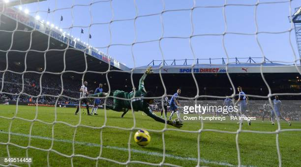 Chelsea's Petr Cech is beaten by Newcastle's Moussa Sissoko for his second goal during the Barclays Premier League match at St James' Park Newcastle