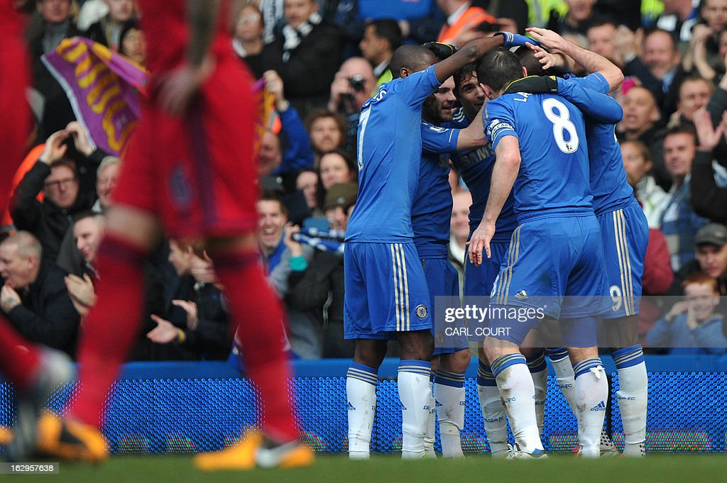 Chelsea's players celebrate after French-born Senegalese striker Demba Ba (R) scores the opening goal of the English Premier League football match between Chelsea and West Bromwich Albion at Stamford Bridge in London on March 2, 2013. USE. No use with unauthorized audio, video, data, fixture lists, club/league logos or 'live' services. Online in-match use limited to 45 images, no video emulation. No use in betting, games or single club/league/player publications.