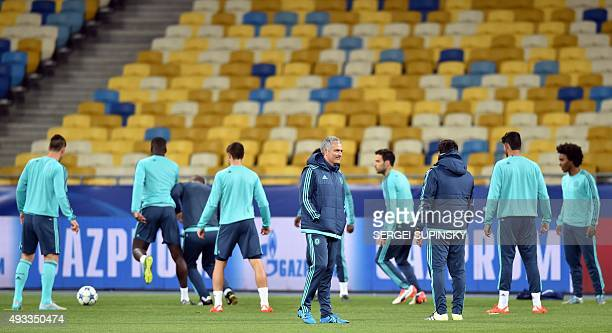 Chelsea's Portuguese coach Jose Mourinho looks on as his players take part in a training session at Olimpiskiy Stadium in Kiev on October 19 a day...