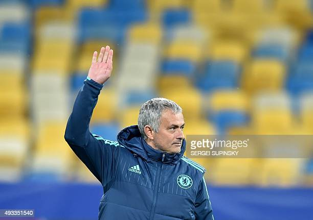 Chelsea's Portuguese coach Jose Mourinho waves during a training session at Olimpiskiy Stadium in Kiev on October 19 a day before their Champion's...