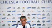 Chelsea's Portuguese manager Jose Mourinho addresses a press conference at the club's training ground in Cobham southeast England on August 16 2013...