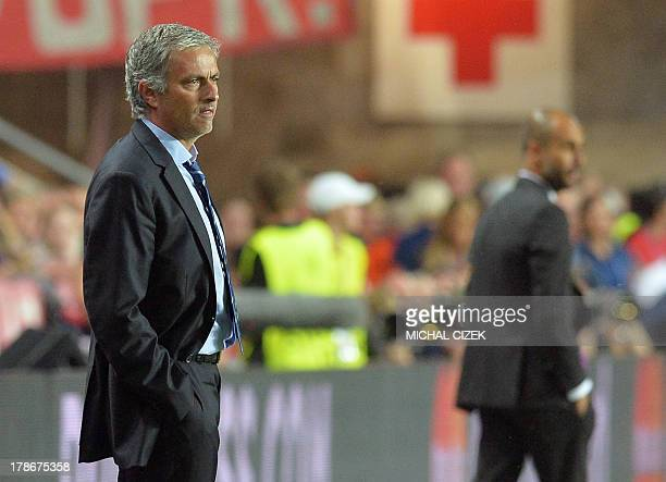 Chelsea's Portuguese manager Jose Mourinho and Bayern Munich's Spanish head coach Pep Guardiola follow the action from the sideline during the UEFA...