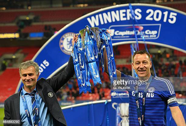 Chelsea's Portuguese manager Jose Mourinho and Chelsea's captain English defender John Terry celebrate with the trophy during the presentation after...