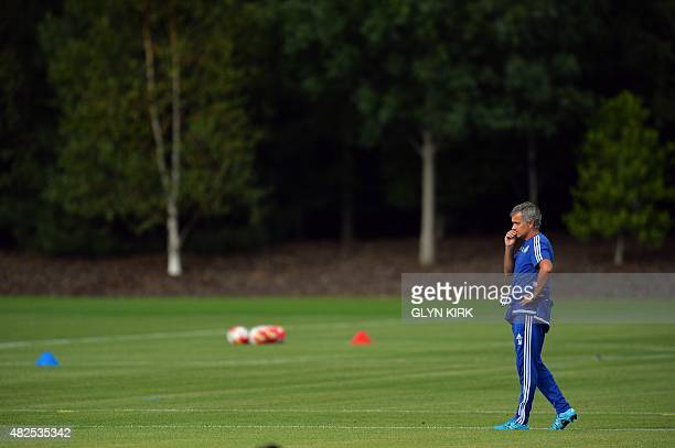 Chelsea's Portuguese manager Jose Mourinho attends a team training session at Chelsea's training ground in Stoke D'Abernon south of London on July 31...
