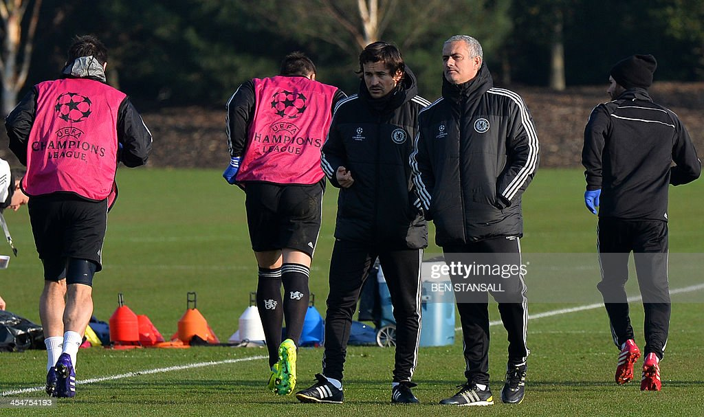 Chelsea's Portuguese manager Jose Mourinho attends a training session at the club's training ground in Cobham Surrey south of London on December 10...