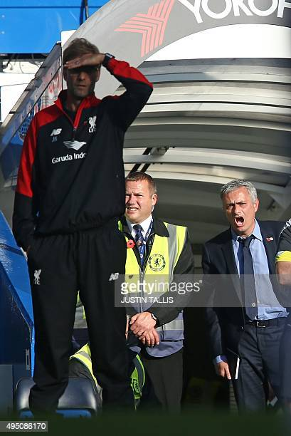 Chelsea's Portuguese manager Jose Mourinho gestures as Liverpool's German manager Jurgen Klopp looks on during the English Premier League football...