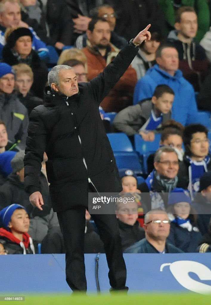 Chelsea's Portuguese manager Jose Mourinho gestures during the English Premier League football match between Chelsea and Swansea City at Stamford Bridge in London on December 26, 2013. Chelsea won the game 1-0. USE. No use with unauthorized audio, video, data, fixture lists, club/league logos or live services. Online in-match use limited to 45 images, no video emulation. No use in betting, games or single club/league/player publications.