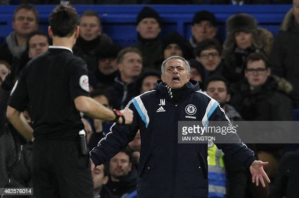 Chelsea's Portuguese manager Jose Mourinho gestures to referee Mark Clattenburg during the English Premier League football match between Chelsea and...