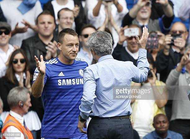 Chelsea's Portuguese manager Jose Mourinho greets Chelsea's English defender John Terry before the English Premier League football match between...