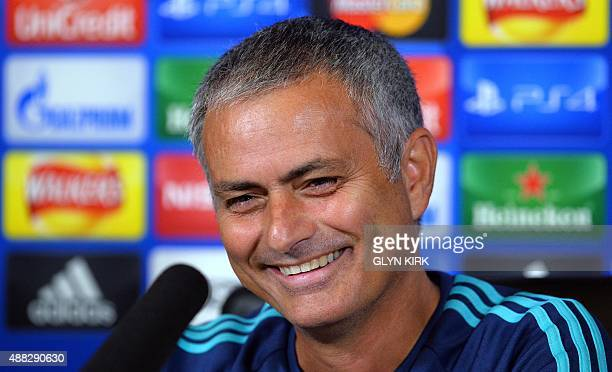 Chelsea's Portuguese manager Jose Mourinho smiles as he gives a press conference at Chelsea's training ground in Stoke D'Abernon near London on...