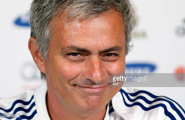 Chelsea's Portuguese manager Jose Mourinho smiles during a press conference at the club's training ground in Cobham southeast England on August 16...
