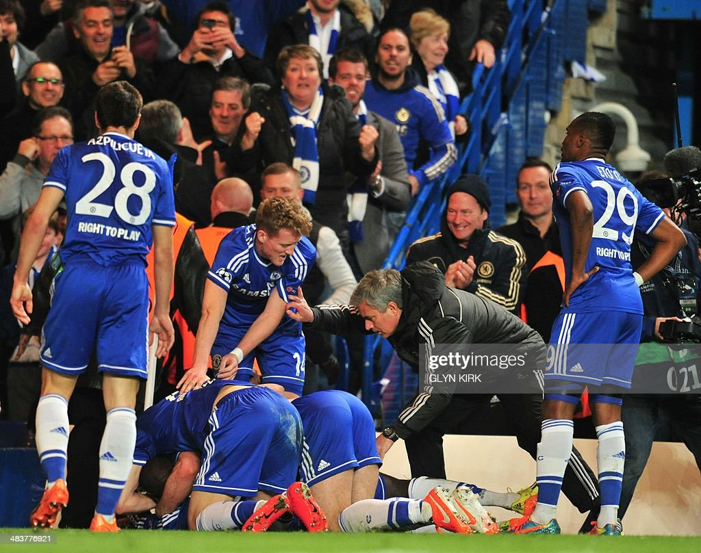 Chelsea's Portuguese manager Jose Mourinho (2R) talks to his players as they celebrate their second goal scored by Chelsea's French-born Senegalese striker Demba Ba during the UEFA Champions League quarter final second leg football match between Chelsea and Paris Saint-Germain at Stamford Bridge in London on April 8, 2014.