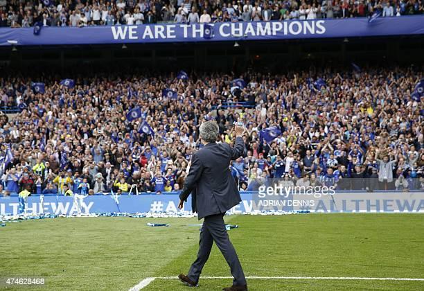 Chelsea's Portuguese manager Jose Mourinho waves to fans following the Premier League trophy presentation after the English Premier League football...
