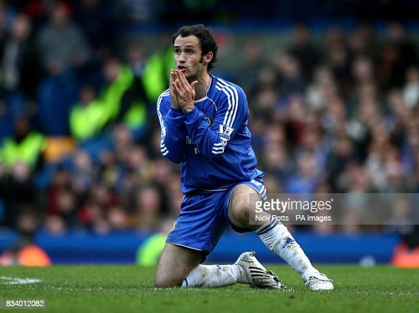 Chelsea's Ricardo Carvalho pleads his innocence to referee Phil Dowd after a two footed challenge on Aston Villa's Gabriel Agbonlahor resulting in a...