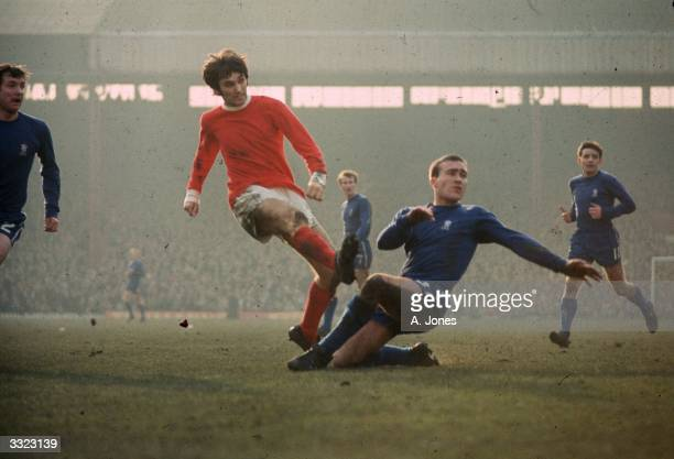 Chelsea's Ron Harris tackles Manchester United's George Best