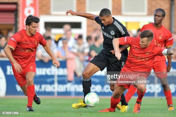 Chelsea's Ruben LoftusCheek battles Ilkeston players for the ball