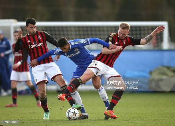 Chelsea's Ruben LoftusCheek is tackled by a combination of AC Milan's Zan Benedicic and Andrea Petagna