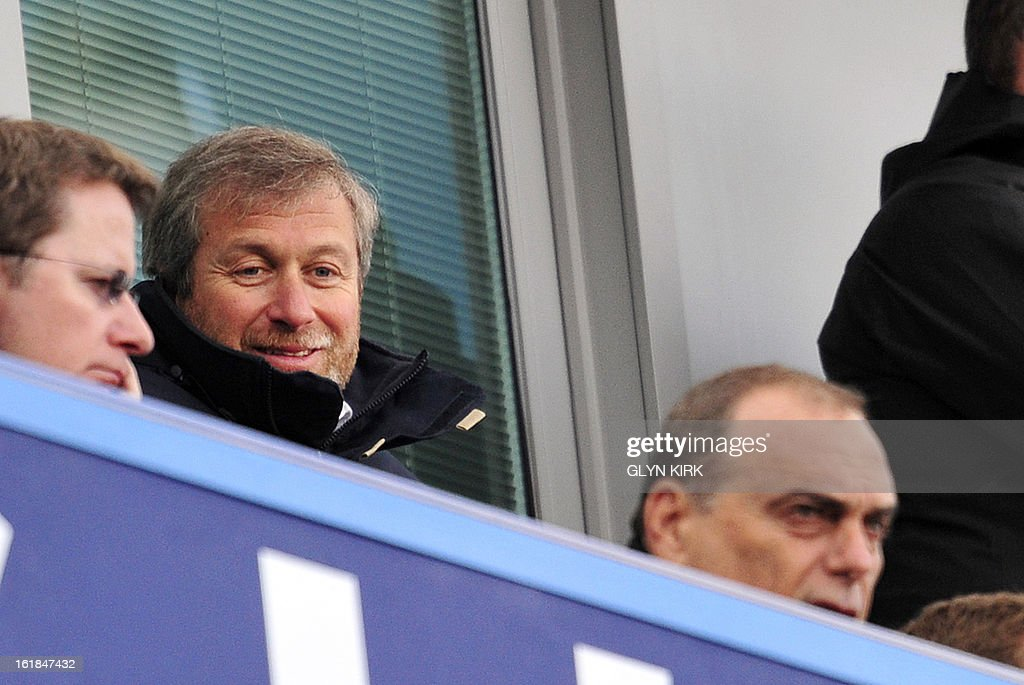 """Chelsea's Russian owner Roman Abramovich (2nd L) and former manager Avram Grant (R) watch the English FA Cup fourth round replay football match between Chelsea and Brentford at Stamford Bridge in London on February 17, 2013. Chelsea won the game 4-0. USE. No use with unauthorized audio, video, data, fixture lists, club/league logos or """"live"""" services. Online in-match use limited to 45 images, no video emulation. No use in betting, games or single club/league/player publications."""