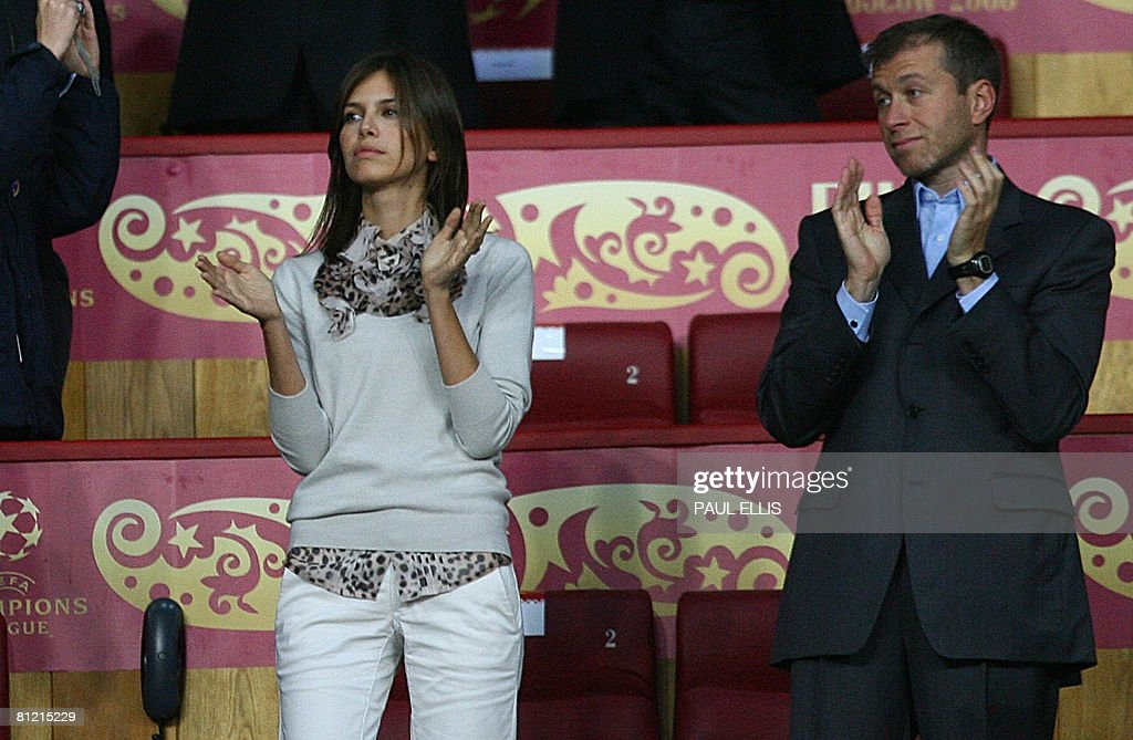 Chelsea's Russian owner Roman Abramovich (R) and new girlfriend Darya Zhukova watch his team play Manchester United during the final of the UEFA Champions League football match at the Luzhniki stadium in Moscow on May 21, 2008. AFP PHOTO / Paul Ellis