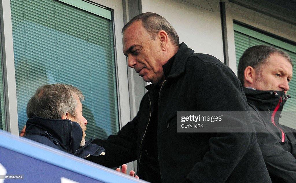 "Chelsea's Russian owner Roman Abramovich (L) is seen with Israeli former manager Avram Grant (R) during the English FA Cup fourth round replay football match between Chelsea and Brentford at Stamford Bridge in London on February 17, 2013. Chelsea won the game 4-0. USE. No use with unauthorized audio, video, data, fixture lists, club/league logos or ""live"" services. Online in-match use limited to 45 images, no video emulation. No use in betting, games or single club/league/player publications."