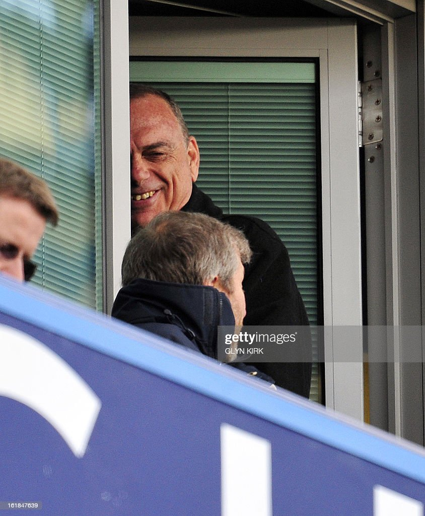 """Chelsea's Russian owner Roman Abramovich is seen with Israeli former manager Avram Grant (up) during the English FA Cup fourth round replay football match between Chelsea and Brentford at Stamford Bridge in London on February 17, 2013. Chelsea won the game 4-0. USE. No use with unauthorized audio, video, data, fixture lists, club/league logos or """"live"""" services. Online in-match use limited to 45 images, no video emulation. No use in betting, games or single club/league/player publications."""