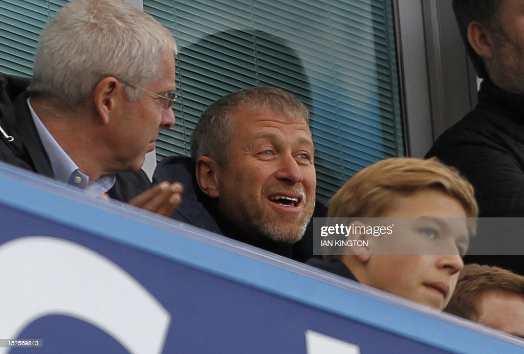 """Chelsea's Russian owner Roman Abramovich looks on during the English Premier League football match between Chelsea and Stoke City at Stamford Bridge in London, on September 22, 2012. USE. No use with unauthorized audio, video, data, fixture lists, club/league logos or """"live"""" services. Online in-match use limited to 45 images, no video emulation. No use in betting, games or single club/league/player publications."""