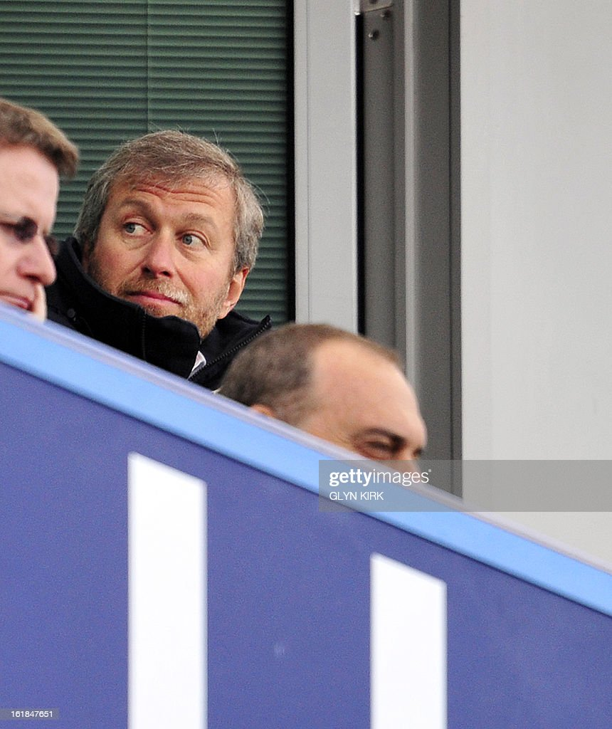 """Chelsea's Russian owner Roman Abramovich (up) looks on during the English FA Cup fourth round replay football match between Chelsea and Brentford at Stamford Bridge in London on February 17, 2013. Chelsea won the game 4-0. USE. No use with unauthorized audio, video, data, fixture lists, club/league logos or """"live"""" services. Online in-match use limited to 45 images, no video emulation. No use in betting, games or single club/league/player publications."""