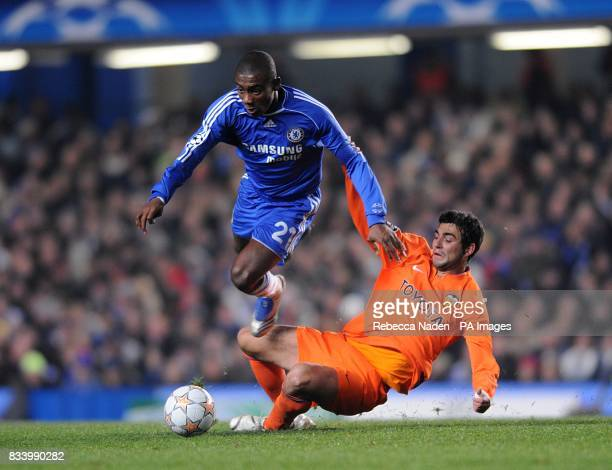 Chelsea's Salomon Kalou and Valencia's Raul Albiol battle for the ball