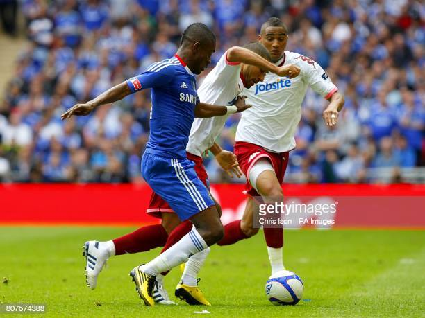 Chelsea's Salomon Kalou battles for the ball with Portsmouth's Hayden Mullins and KevinPrince Boateng