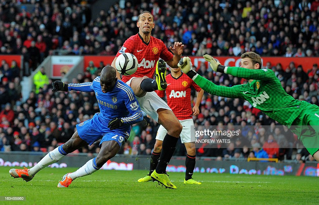 """Chelsea's Senegalese forward Demba Ba (L) vies with Manchester United's Spanish goalkeeper David de Gea (R) and Manchester United's English defender Rio Ferdinand (C) during the English FA Cup quarter-final football match between Manchester United and Chelsea at Old Trafford, Manchester, northwest England on March 10, 2013. USE. No use with unauthorized audio, video, data, fixture lists, club/league logos or """"live"""" services. Online in-match use limited to 45 images, no video emulation. No use in betting, games or single club/league/player publications."""