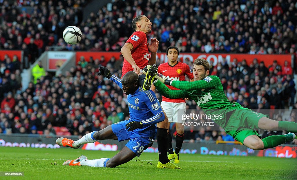 "Chelsea's Senegalese forward Demba Ba (L) vies with Manchester United's Spanish goalkeeper David de Gea (R) and Manchester United's English defender Rio Ferdinand (C) during the English FA Cup quarter-final football match between Manchester United and Chelsea at Old Trafford, Manchester, northwest England on March 10, 2013. AFP PHOTO / ANDREW YATES USE. No use with unauthorized audio, video, data, fixture lists, club/league logos or ""live"" services. Online in-match use limited to 45 images, no video emulation. No use in betting, games or single club/league/player publications."