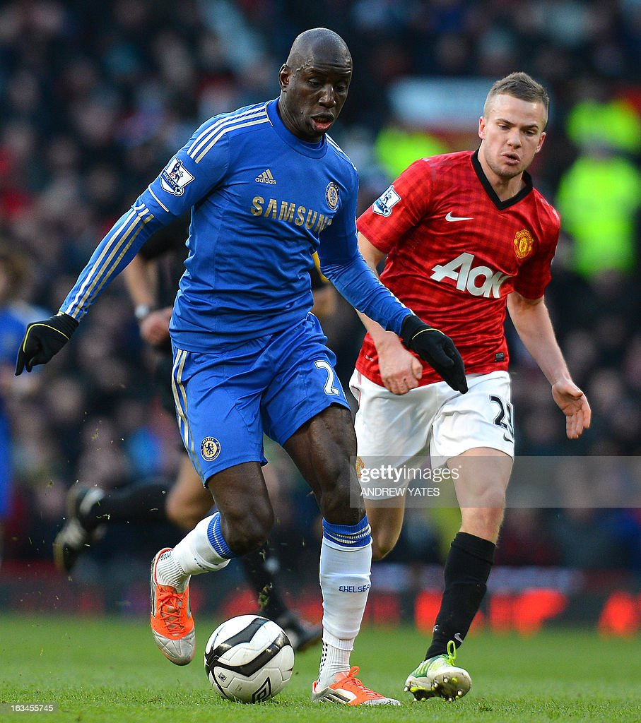 "Chelsea's Senegalese forward Demba Ba (L) vies with Manchester United's English midfielder Tom Cleverley (R) during the English FA Cup quarter-final football match between Manchester United and Chelsea at Old Trafford, Manchester, northwest England on March 10, 2013. USE. No use with unauthorized audio, video, data, fixture lists, club/league logos or ""live"" services. Online in-match use limited to 45 images, no video emulation. No use in betting, games or single club/league/player publications."