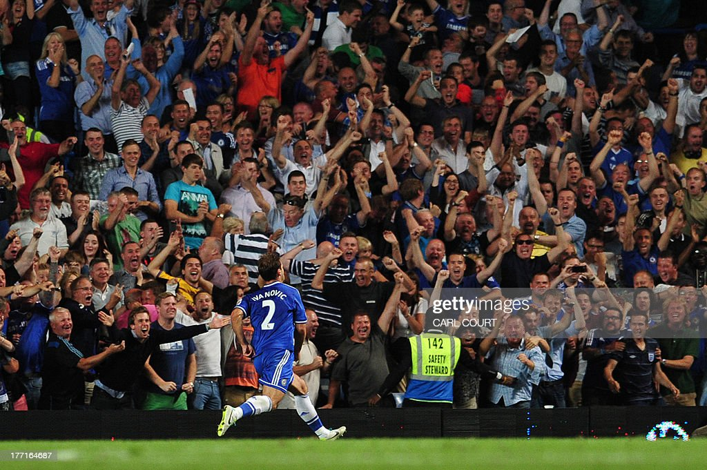 Chelsea's Serbian defender Branislav Ivanovic celebrates in front of supporters after scoring their second goal during the English Premier League football match between Chelsea and Aston Villa at Stamford Bridge in London on August 21, 2013.