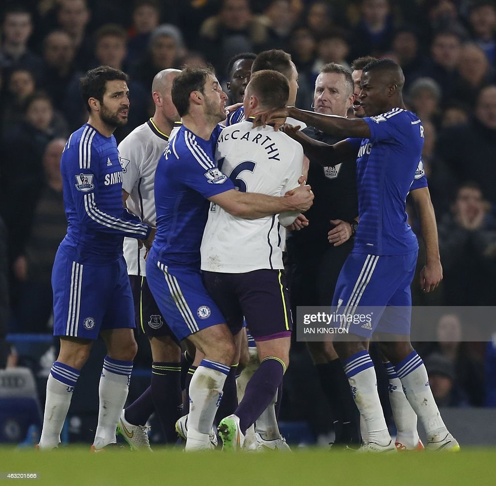 Chelseas Serbian defender <a gi-track='captionPersonalityLinkClicked' href=/galleries/search?phrase=Branislav+Ivanovic&family=editorial&specificpeople=607152 ng-click='$event.stopPropagation()'>Branislav Ivanovic</a> (3rd L) clashes with Everton's Scottish-born Irish midfielder <a gi-track='captionPersonalityLinkClicked' href=/galleries/search?phrase=James+McCarthy+-+Soccer+Player&family=editorial&specificpeople=8984734 ng-click='$event.stopPropagation()'>James McCarthy</a> during the English Premier League football match between Chelsea and Everton at Stamford Bridge in London on February 11, 2015. Chelsea won the game 1-0. AFP PHOTO / IAN KINGTON OR 'LIVE' SERVICES. ONLINE