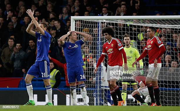 Chelsea's Serbian midfielder Nemanja Matic and Chelsea's English defender John Terry claim a penalty after Terry's shot was blocked by Manchester...