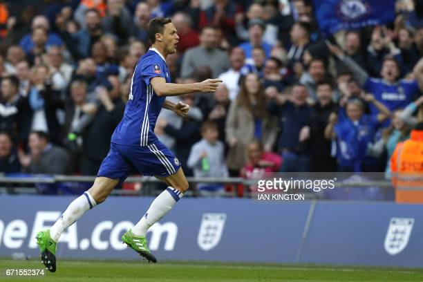 Chelsea's Serbian midfielder Nemanja Matic celebrates after scoring their fourth goal during the FA Cup semifinal football match between Tottenham...