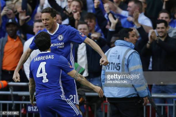 Chelsea's Serbian midfielder Nemanja Matic celebrates scoring Chelsea's fourth goal with Chelsea's Spanish midfielder Cesc Fabregas during the FA Cup...