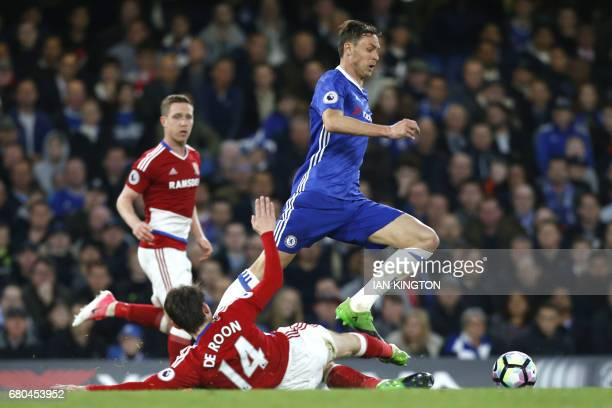 Chelsea's Serbian midfielder Nemanja Matic skips a tackle by Middlesbrough's Dutch midfielder Marten de Roon during the English Premier League...